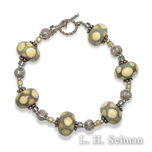 Ann Wasserman ivory-spotted silver glass bead bracelet. by Ann Wasserman