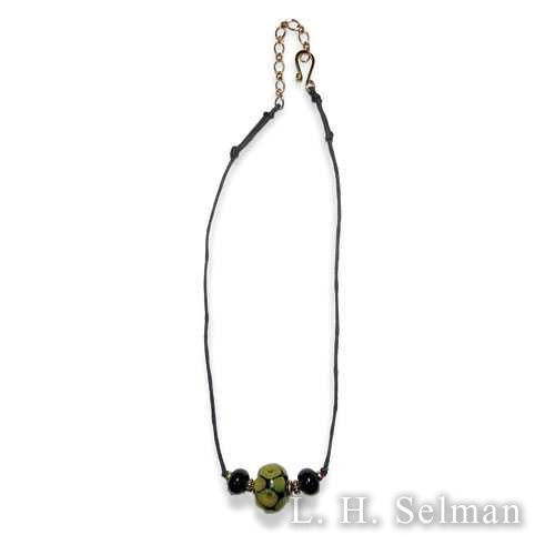 Wasserman necklace w/lrg ocher & black bead/2 sml black beads by Ann Wasserman