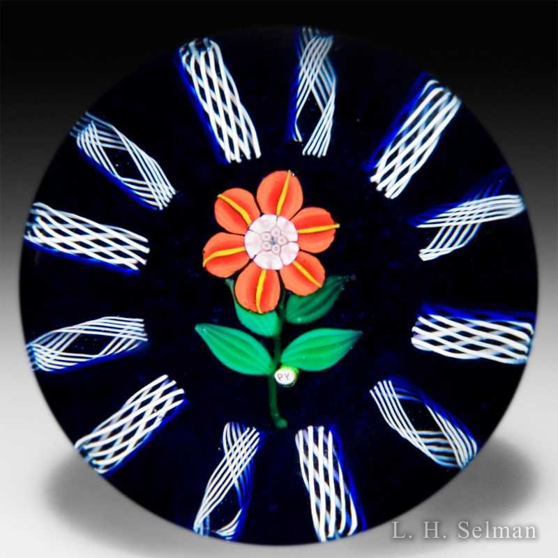 Paul Ysart red flower and radial latticinio glass paperweight. by Paul Ysart