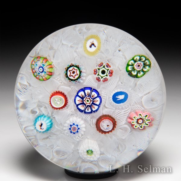 Antique Baccarat scattered millefiori on white muslin glass paperweight. by  Baccarat Antique