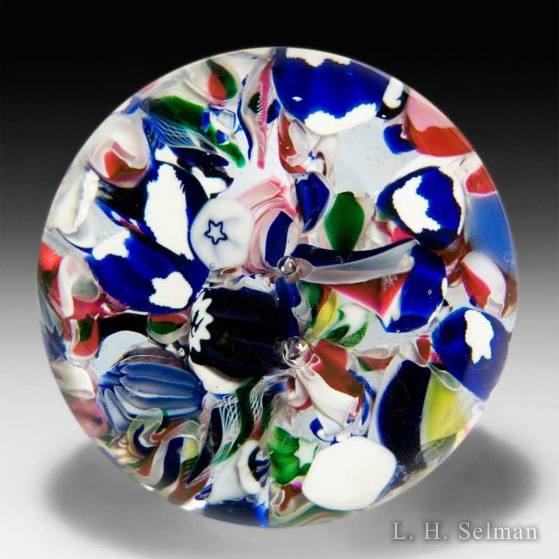Antique New England scrambled millefiori with partial eagle silhouette canes glass glass paperweight. by  American