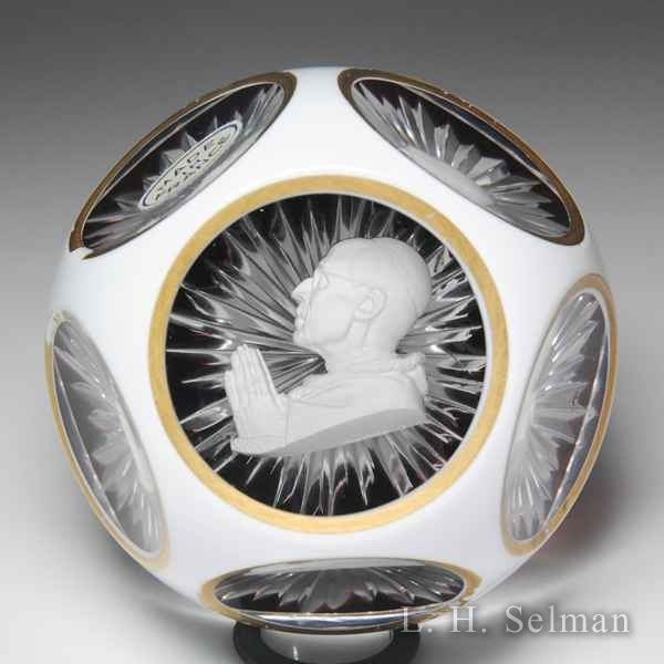 Baccarat Pope Pius sulphide overlay faceted glass paperweight. by Baccarat Moderns