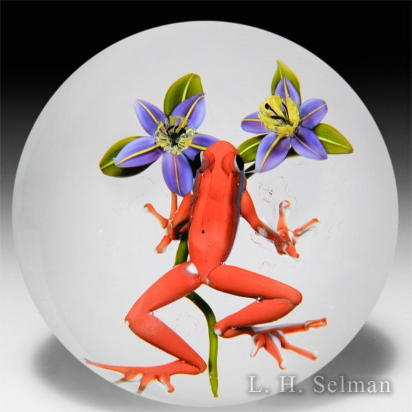 Jim D'Onofrio 1997 red frog and two purple flowers glass glass paperweight. by Jim D'Onofrio