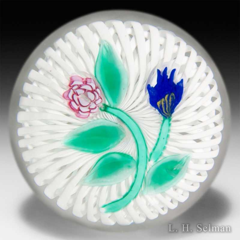 Miscellaneous blue and pink flowers on latticinio paperweight. by Misc Modern