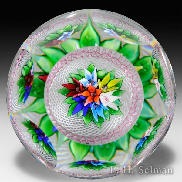 Saint Louis 1977 upright bouquet and torsade faceted glass paperweight. by  Saint Louis