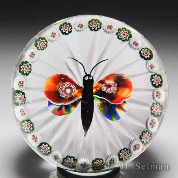 Antique Baccarat butterfly and millefiori garland glass paperweight. by  Baccarat Antique