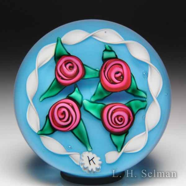 Charles Kaziun Junior four roses and white torsade paperweight. by Charles Kaziun Junior