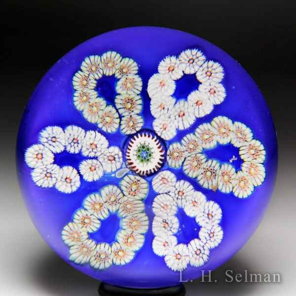 Antique Saint Louis looped millefiori garlands on cerulean blue ground paperweight. by Saint Louis Antique