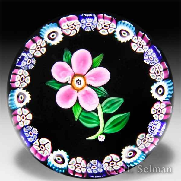 Paul Ysart pink flower with border garland glass paperweight. by Paul Ysart