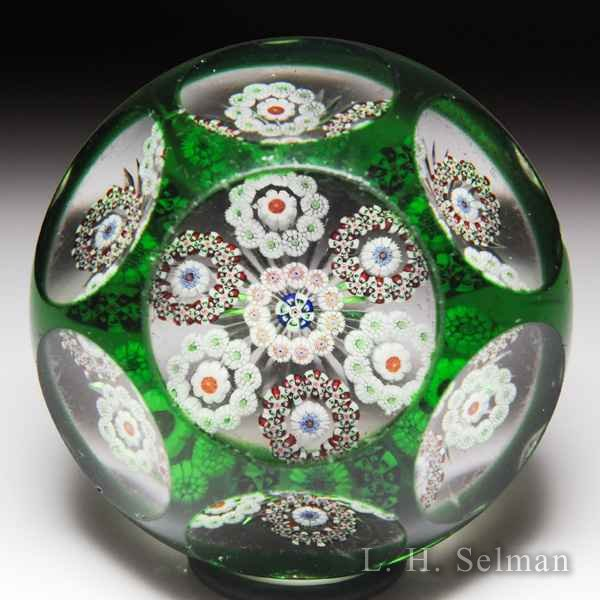 Antique Baccarat circular millefiori garlands faceted green-flash overlay paperweight. by  Baccarat Antique