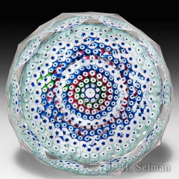 Whitefriars 1972 close concentric millefiori with all-over geometric faceting glass paperweight. by  Whitefriars