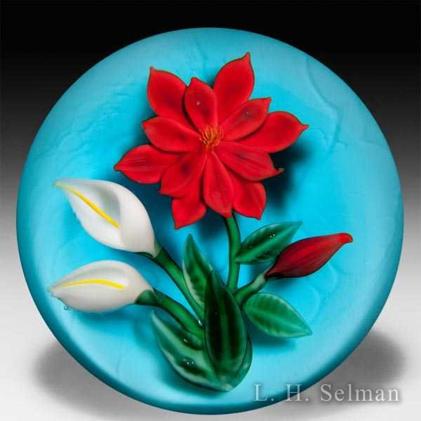 Randall Grubb 1987 red poinsettia and two lilies glass paperweight. by Randall Grubb