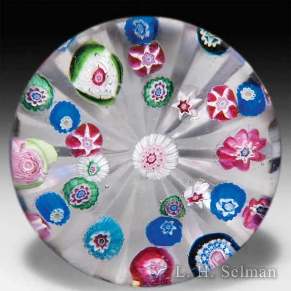 Antique, possibly Bohemian, patterned millefiori with two roses on star-cut ground glass paperweight. by  Misc Antique