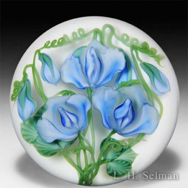 Lundberg Studios 2012 blue sweet peas with buds on sodden snow ground glass paperweight, by Daniel Salazar by Daniel Salazar