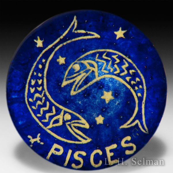 "Gentile Glass ""Pisces"" frit zodiac symbol over bubble studded blue ground glass paperweight. by  Misc Modern"