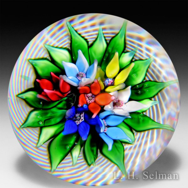 Saint Louis 1977 upright bouquet in latticinio basket paperweight. by Saint Louis