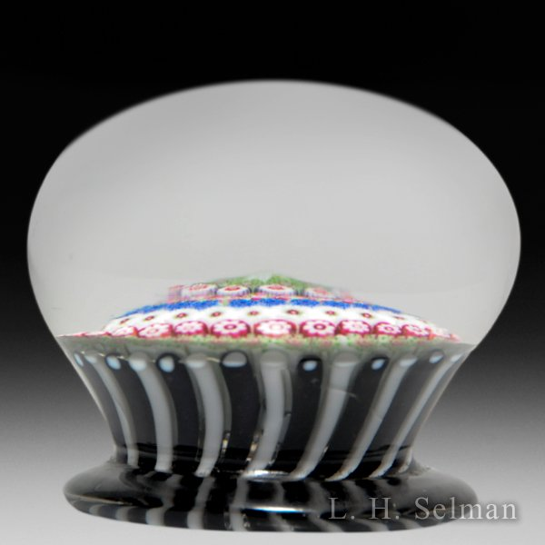 Antique Clichy concentric millefiori pedestal in a stave basket glass paperweight. by  Clichy