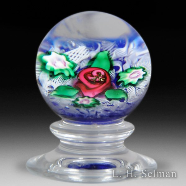 Charles Kaziun Junior pink rose tilted pedestal glass paperweight. by Charles Kaziun Junior
