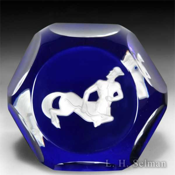 Baccarat Sagittarius zodiac sulphide on translucent blue ground faceted paperweight. by Baccarat Moderns