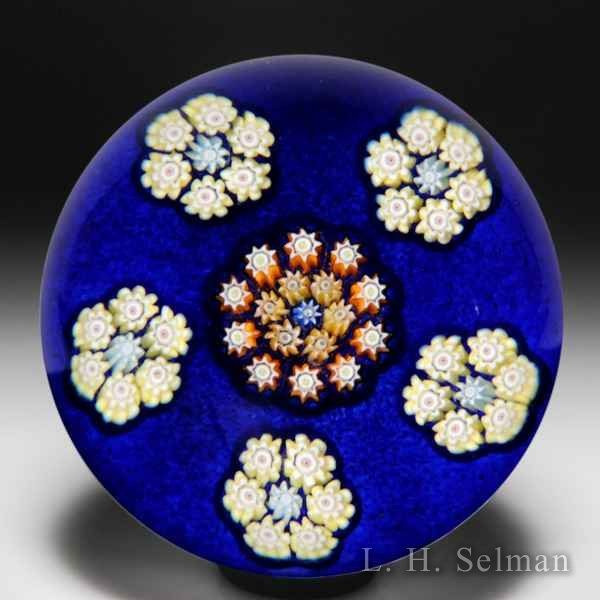 Perthshire Paperweights medium patterned millefiori on cobalt blue ground glass paperweight. by  Perthshire Paperweights