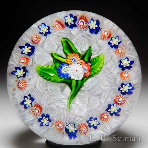 Antique Saint Louis millefiori nosegay with garland on upset muslin paperweight. by Saint Louis Antique
