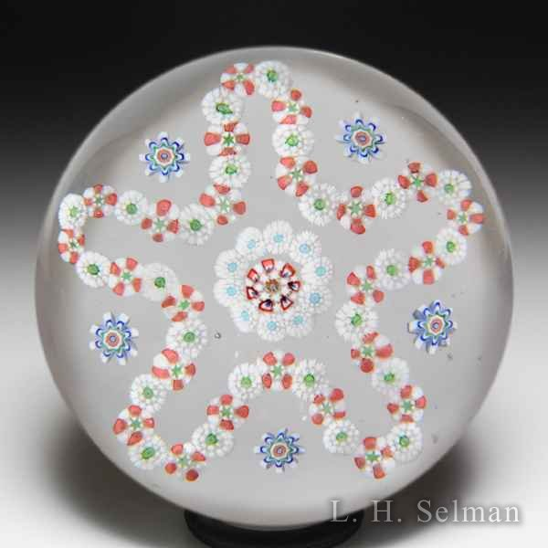 Antique Baccarat cinquefoil millefiori paperweight. by  Baccarat Antique