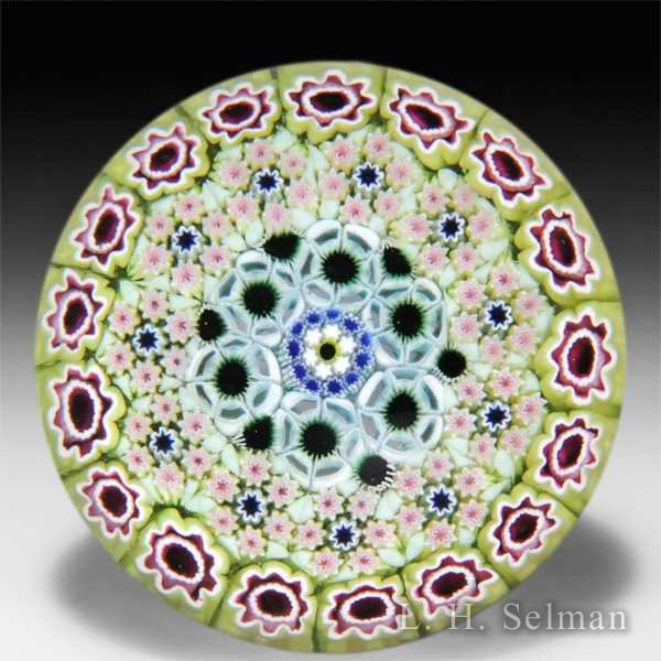 Damon MacNaught 2014 close concentric millefiori in a chartreuse stave basket glass paperweight. by Damon MacNaught