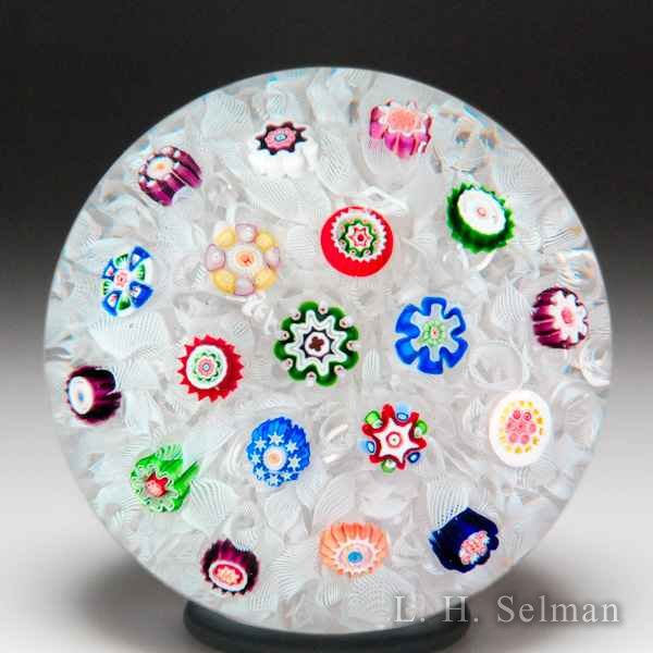 Antique Baccarat scattered millefiori on upset muslin paperweight. by  Baccarat Antique