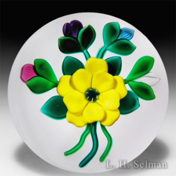 Bobbi Banford yellow flower and buds paperweight. by Bobbi Banford
