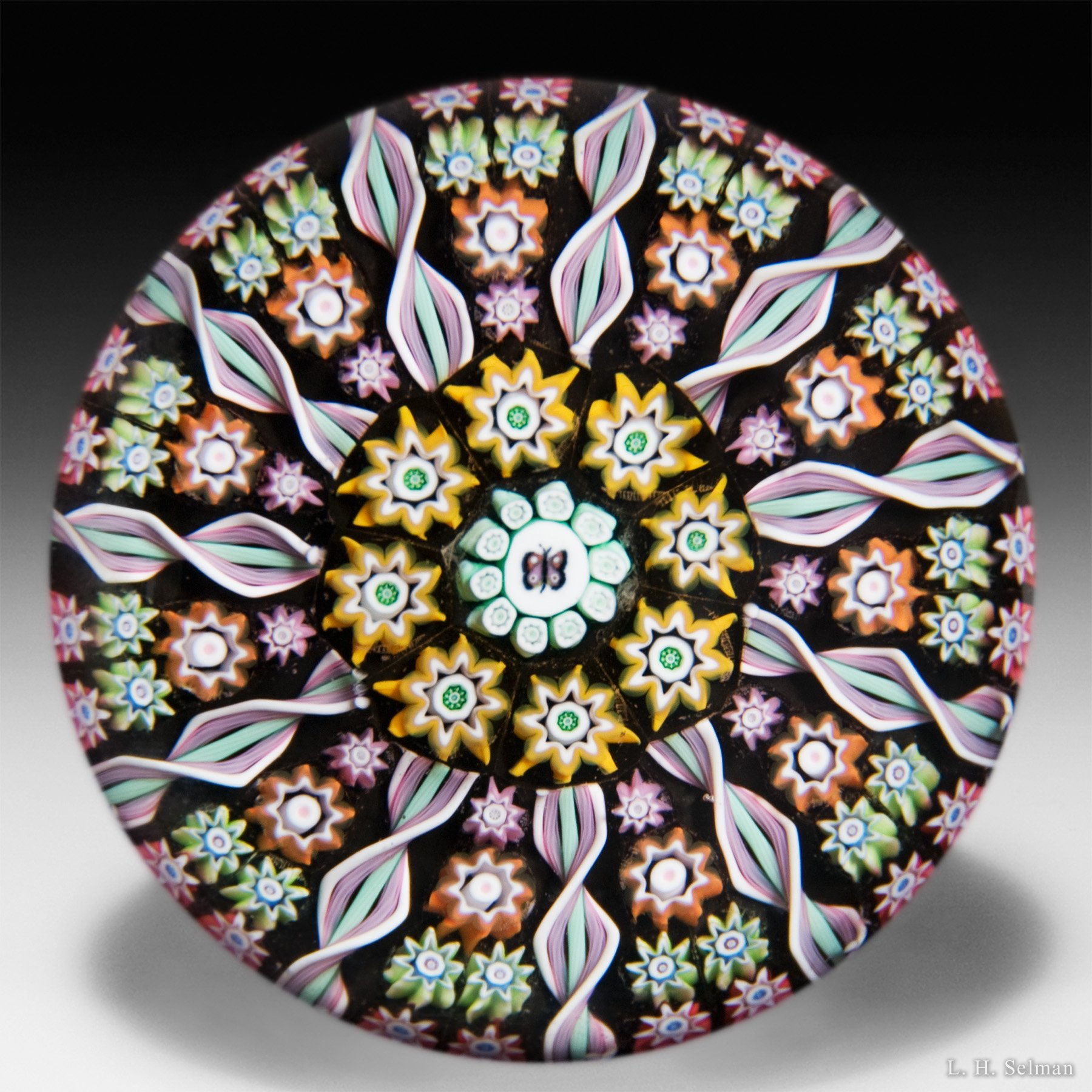 Perthshire Paperweights 1989-1997 butterfly cane and patterned medium millefiori glass glass paperweight.  by  Perthshire Paperweights