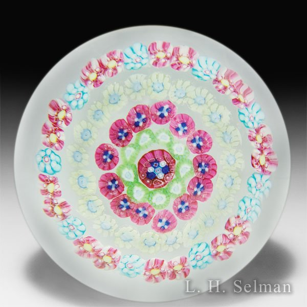 Baccarat spaced concentric millefiori on clear ground glass glass paperweight. by Baccarat Moderns
