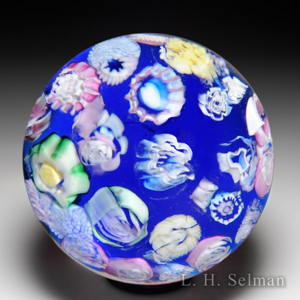 Pairpoint scattered millefiori on blue ground miniature glass paperweight. by  Pairpoint