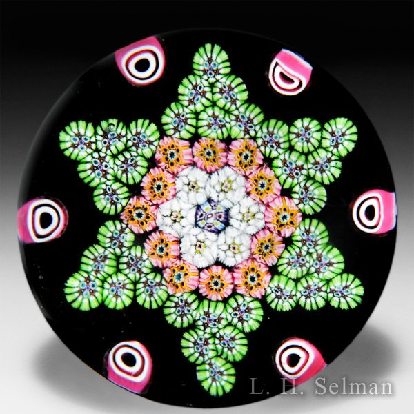 Paul Ysart millefiori star pattern glass paperweight. by Paul Ysart