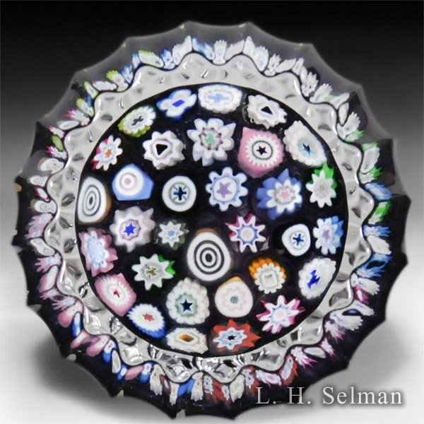 Caithness Glass 2014 minature concentric millefiori multi-faceted on purple color ground glass paperweight, by Peter McDougall.  by Caithness  Glass Inc