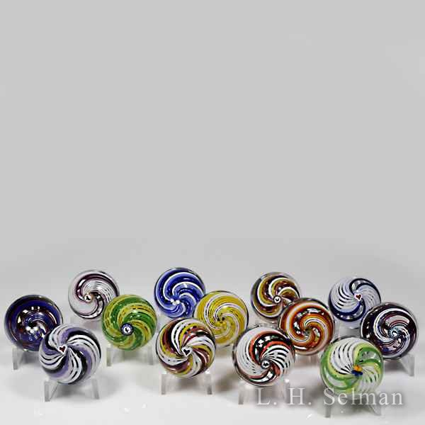 Mike Hunter 2014 swirl miniature glass paperweights. by Twists Glass Studio