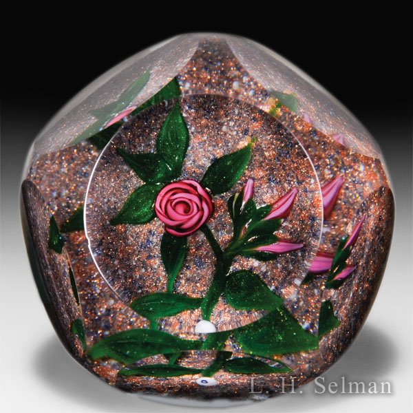 Ray Banford pink rose with buds on aventurine ground faceted petite paperweight. by Ray Banford
