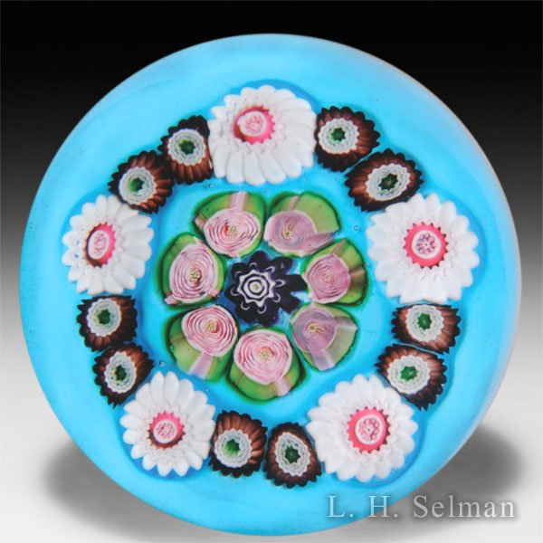 Antique Clichy spaced concentric millefiori and roses over opaque turquoise ground glass paperweight. by  Clichy