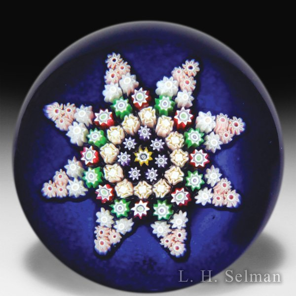 Perthshire Paperweights patterned millefiori color ground glass paperweight. by  Perthshire Paperweights