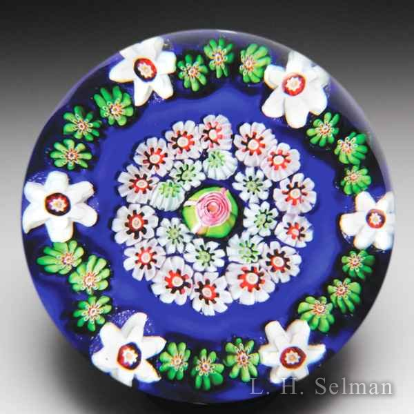 Antique Clichy spaced concentric millefiori on opaque blue ground glass paperweight. by  Clichy