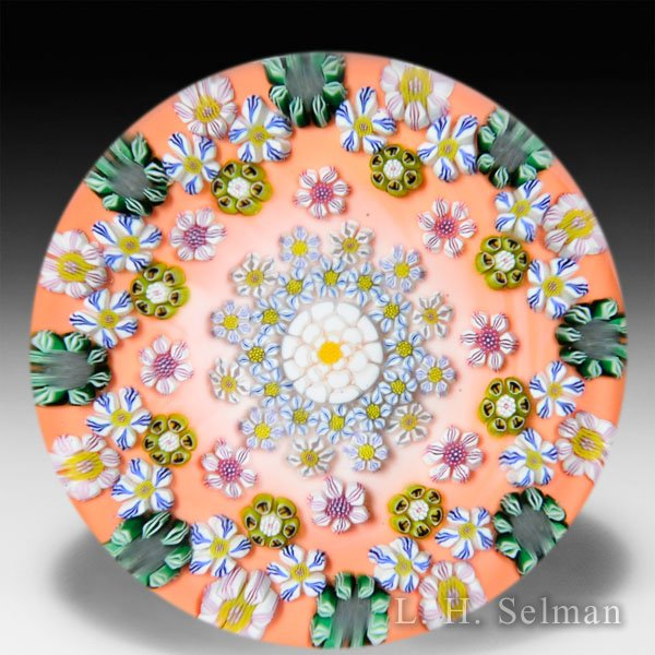 Drew Ebelhare 2015 patterned millefiori flower canes on orange ground glass paperweight. by Drew Ebelhare & Sue Fox
