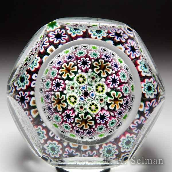 Damon MacNaught 2014 close concentric millefiori in white cane stave basket faceted paperweight. by Damon MacNaught