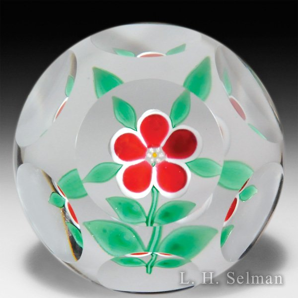 Pete Lewis 1974 red primrose blossom faceted glass paperweight. by Pete Lewis
