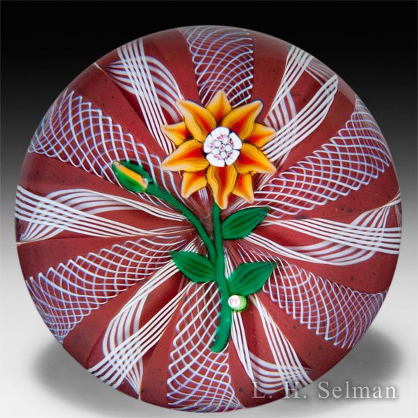 Paul Ysart orange clematis on red and white ribbons glass paperweight. by Paul Ysart