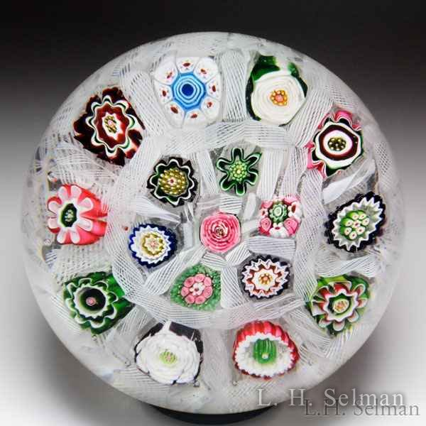 Antique Clichy three roses and millefiori chequer glass paperweight. by  Clichy
