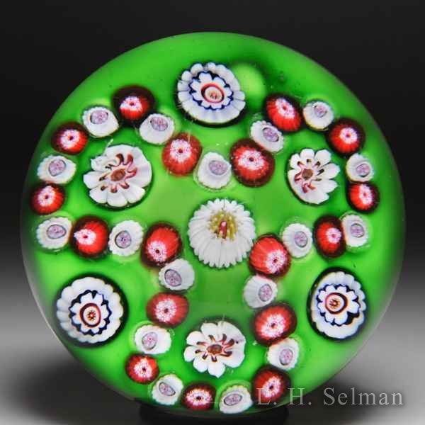 Antique Clichy trefoil millefiori garland on green ground glass paperweight. by  Clichy