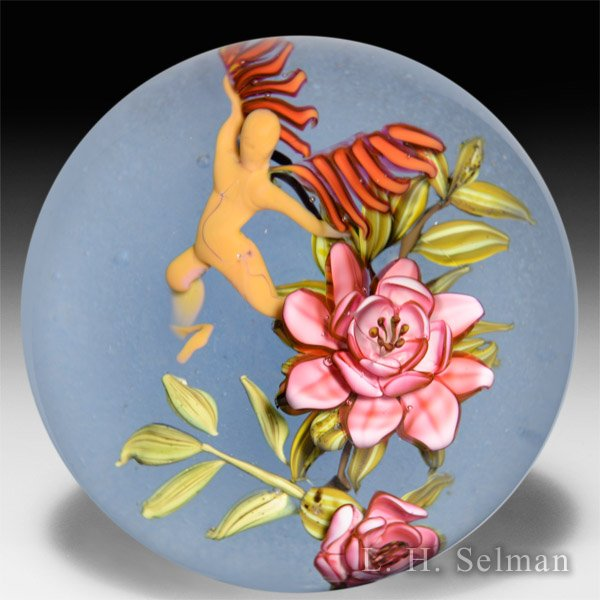 "Eric Hansen 2015 red flowers and ""spirit person"" glass paperweight. by Eric Hansen"