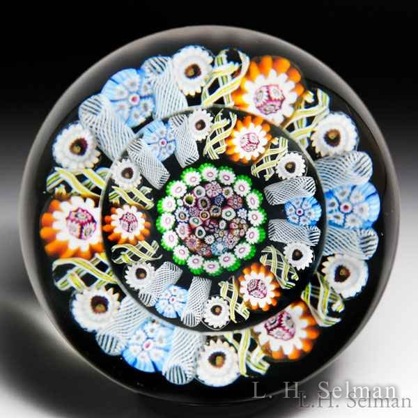 Paul Ysart patterned millefiori faceted glass paperweight. by Paul Ysart