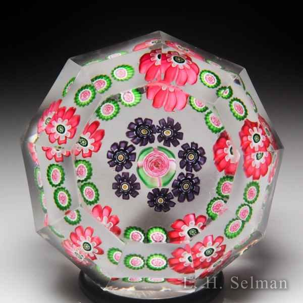 Antique Clichy spaced concentric millefiori miniature faceted glass paperweight. by  Clichy