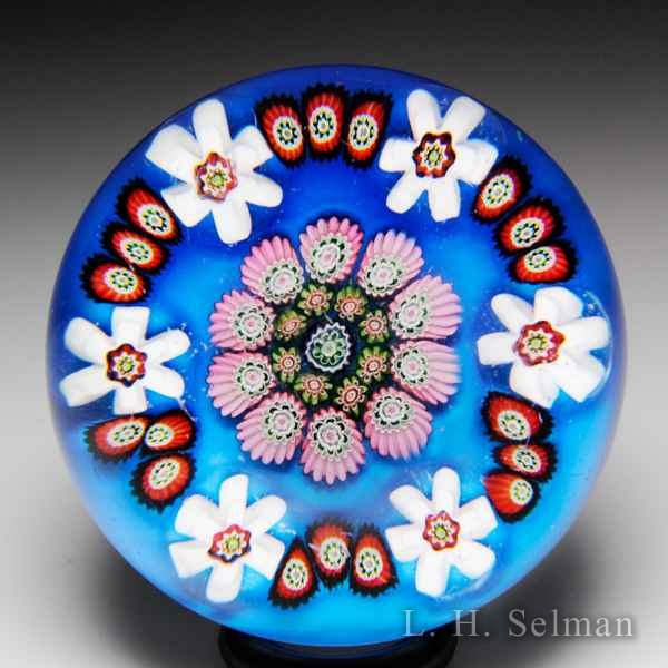 Antique Clichy spaced concentric millefiori over thalo blue color ground glass paperweight. by  Clichy