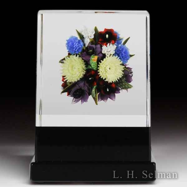 David Graeber 2016 botanical over black pedestal rectangular glass paperweight. by David Graeber